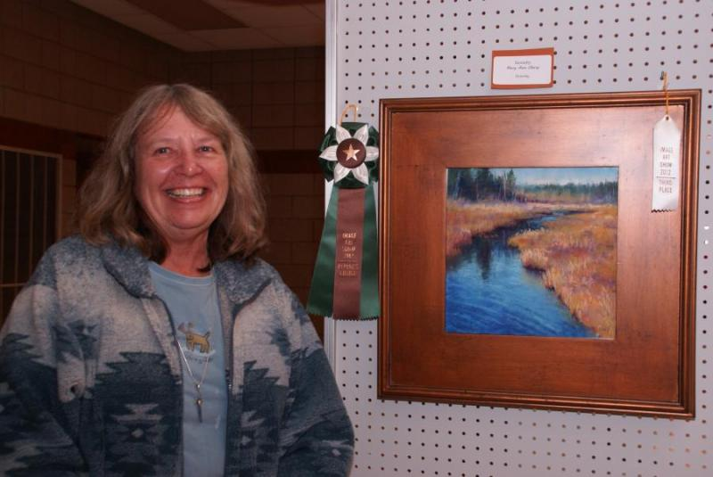 "Mary Ann Cleary of Cambridge with ""Serenity"""